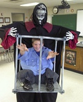 Boy Trapped in Cage by Monster Costume