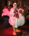 Colonel Sanders riding a Chicken Costume
