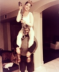 Miley Cyrus riding her Wrecking Ball Costume