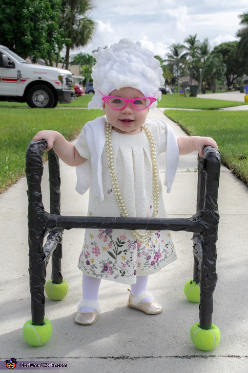 Boca Raton Florida's newest retiree Olivia Ryan enjoying a stroll through the neighborhood., 10 Month Old Retiree Costume