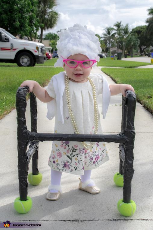 Boca Raton Florida's newest retiree Olivia Ryan enjoying a stroll through the neighborhood., 10 Month Old Retiree Costume