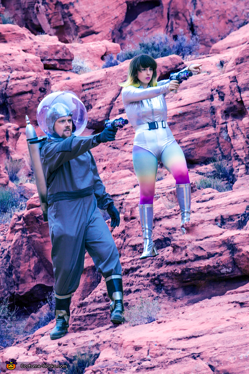 Space Girl and Astronaut fire at the intruders!, 1960s Space Couple Costume