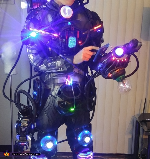 Showing how the hand attachment can be holstered to use touch controls on smartphone., Assimilated Cyborg Costume