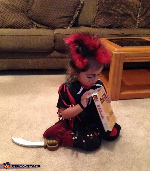 Rufio examining a VHS???  what is this stone age thing, Baby Rufio Costume