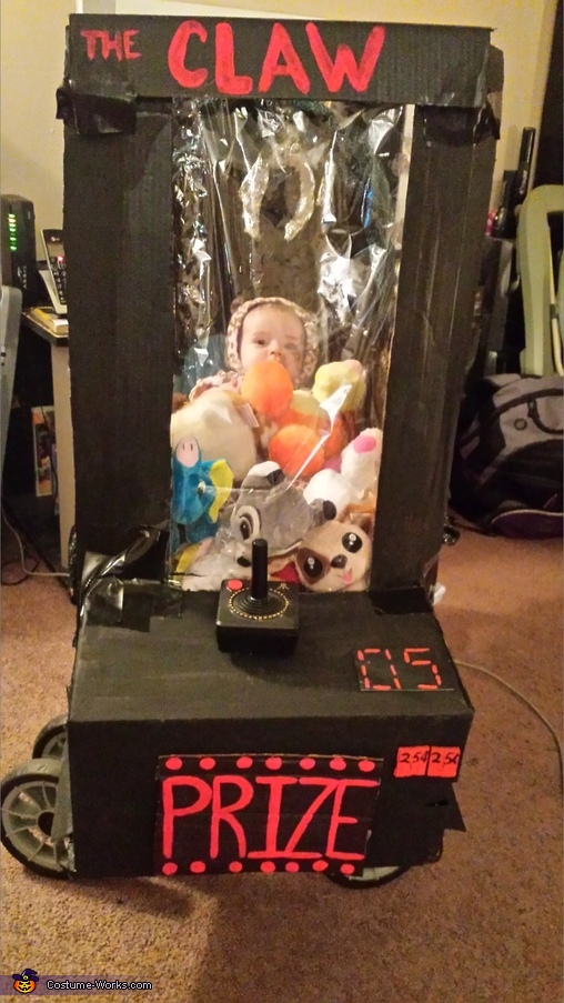 Baby stuck in Arcade Game Costume
