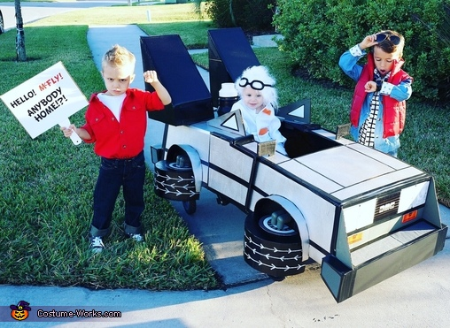 Where we're going Trick or Treating, we don't need roads.....a group picture of these brothers dressed as Marty McFly, Biff Tannen, and Doc Brown, Back to the Future Brothers Costume