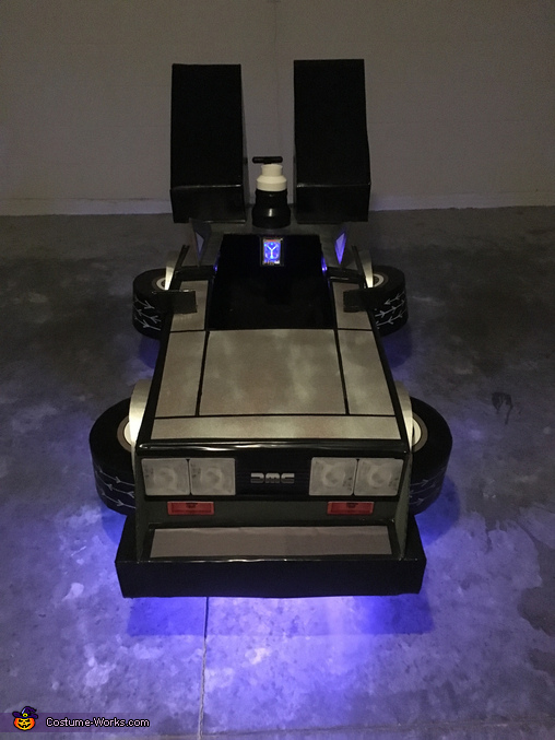 The Delorean wagon, showing the blue lights and flashing flux capacitor, Back to the Future Brothers Costume