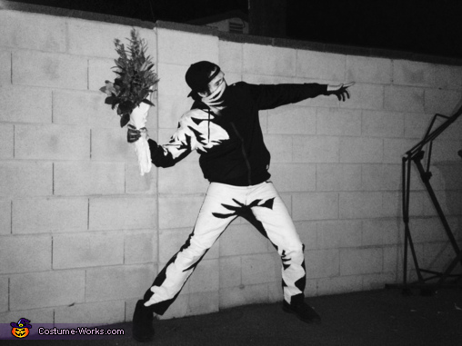 Monochromatic wall pose; meant to look like a stencil, Banksy's Flower Thrower Costume