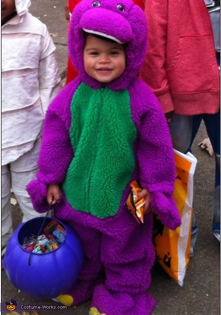 Smiling from ear to ear, Barney is a Dinosaur Costume