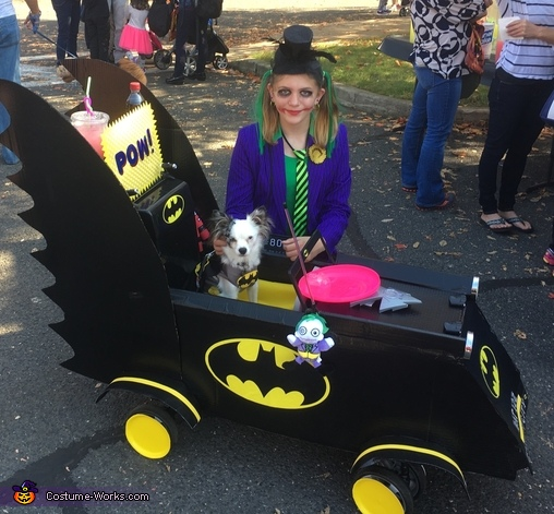 Batman in Batmobile with Joker Costume