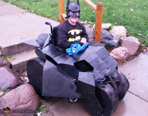 Batman in his Batmobile Costume