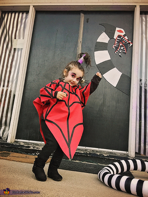 She really loves to dance if it's to Jump in the Line, Lydia from the cartoon Beetlejuice Costume