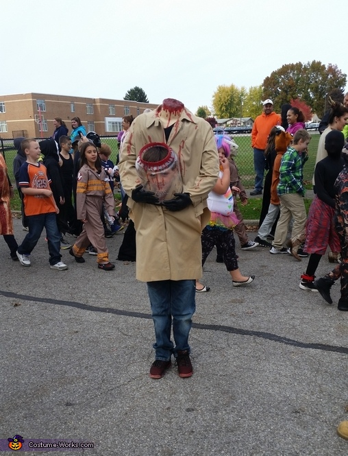 School parade, Beheaded Boy Jar Head Costume