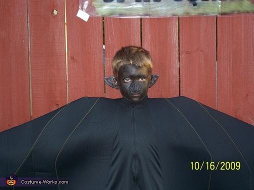 wearing face prothetics , Black Bat Costume