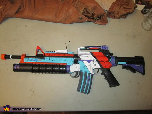 The guns in the Borderlands games are very colorful and futuristic. I found a regular toy gun at a costume store and painted it to match the style., Borderlands 2 Axton Costume