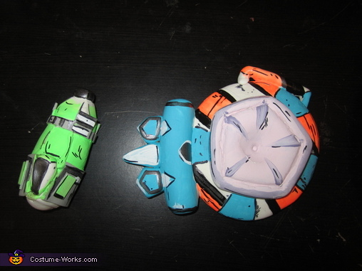 These are accessories the character wears in game. One is a shield (a force field of sort that blocks enemies shots temporarily), and a grenade. These were sculpted entirely with crayola model magic, and painted with acrylics. They even glow in the dark! , Borderlands 2 Axton Costume