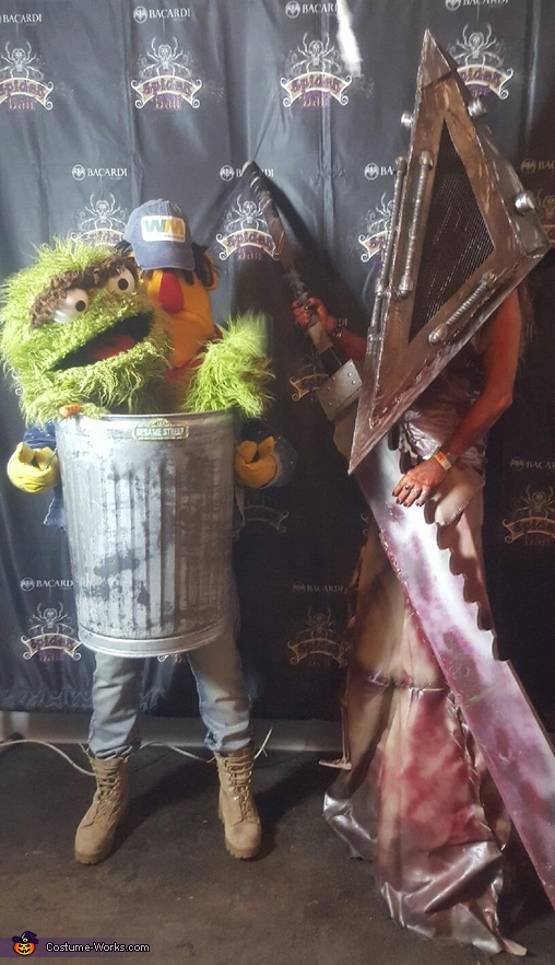 Bruno carrying Oscar the Grouch Costume