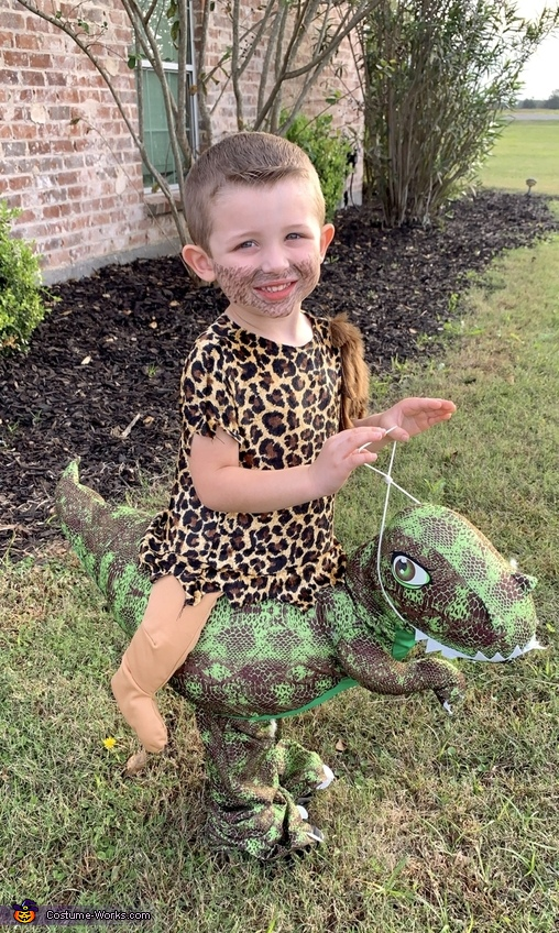 Cave Man riding his Dino Costume