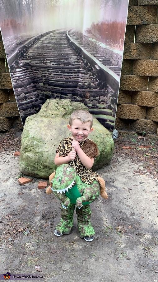 Cave Man riding his Dino Costume