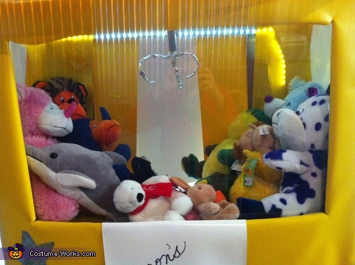 This is an up close picture of the in side of the claw machine. , Claw Machine Costume