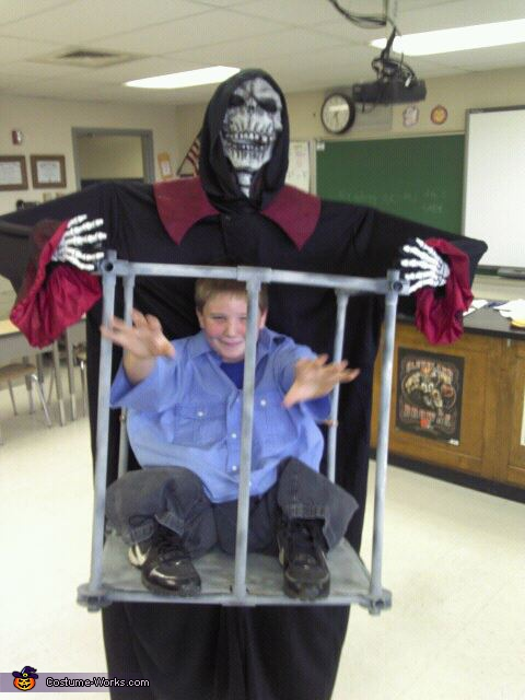 Boy Trapped in a Cage by Monster Costume