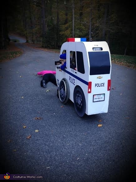 Spread'm, Carly's Cop Car Costume