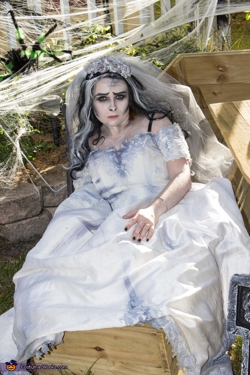 In a custom made coffin, Corpse Bride Costume