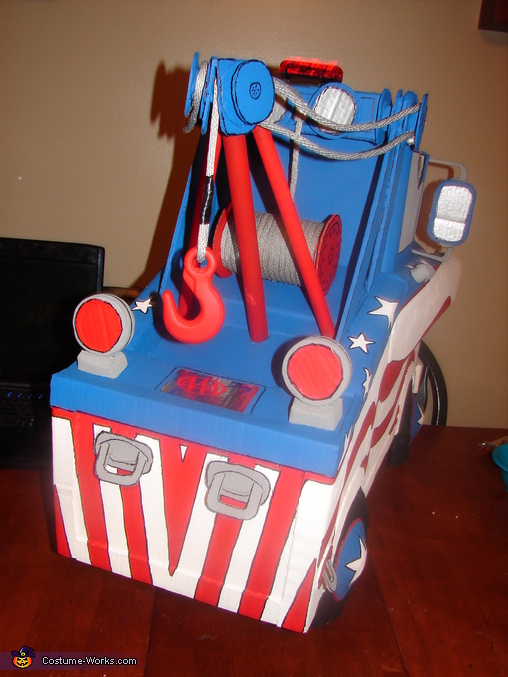 Rear view of Mater, including tow rope and hook, and AAA approved sticker, Mater the Greater Costume