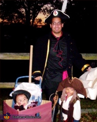 Here we have Dad and the boys..out for a stroll. Possibly up to a little trickery or treatery? I guess that with PIRATES it could be TREACHERY! (EGADS!), Pirates Family Costume