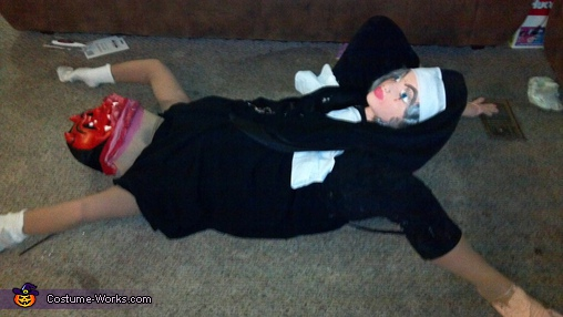 Side veiw, Devil being born by a Nun Costume