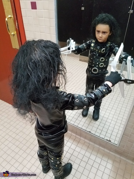 Checking herself out at in a restaurant mirror, Edward Scissorhands Costume