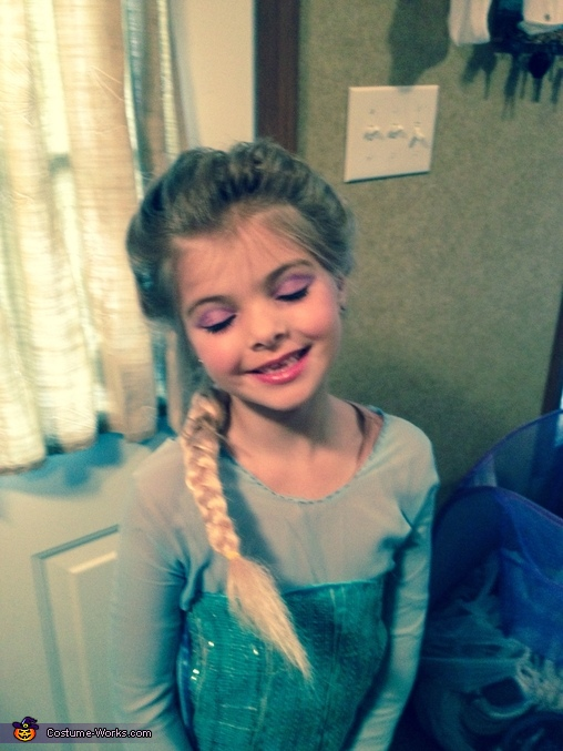 Feeling pretty after her makeup was put on, Elsa Costume