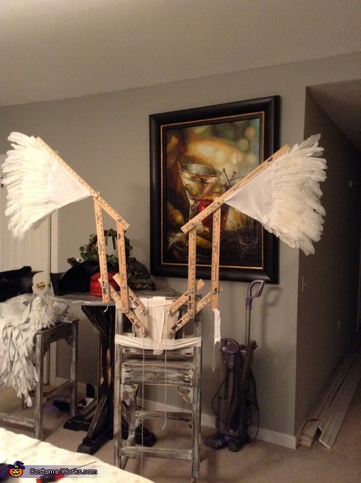The wings, adding the feathers, Fallen Angel Costume