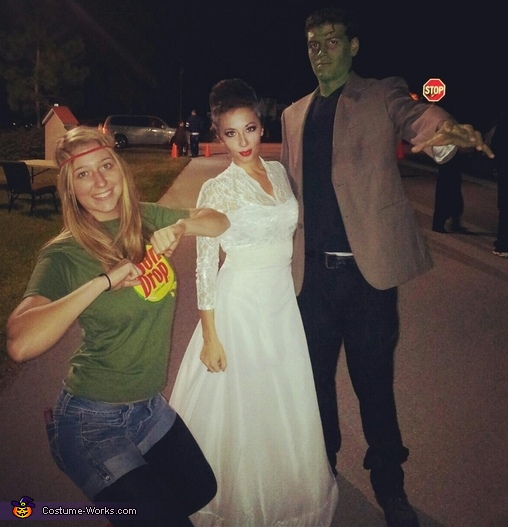 A full body shot, don't mind the Sundrop girl, Frankenstein & the Bride of Frankenstein Couple Costume
