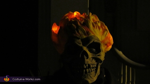 Dark, but a night view of the glowing flames and close up of the mask., Ghost Rider Costume