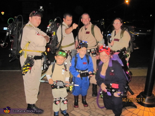 The people in this photo with my son are strangers.We were at a costume contest and they were also Ghost Busters, the difference is, they paid $4000+ for their costumes that were = in appearance to my sons (very cool!), Ghostbuster Costume
