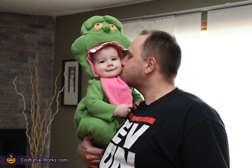 Baby Slimer 7 month old girl smiles, Ghostbusters Family Halloween Costume