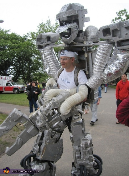 Medium size version: 9 feet tall, 5 foot shoulders, 120 pounds, working claw & gun, Giant Robot Costume