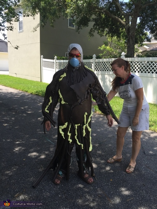 Spraying him with paint, Groot and Rocket Costume