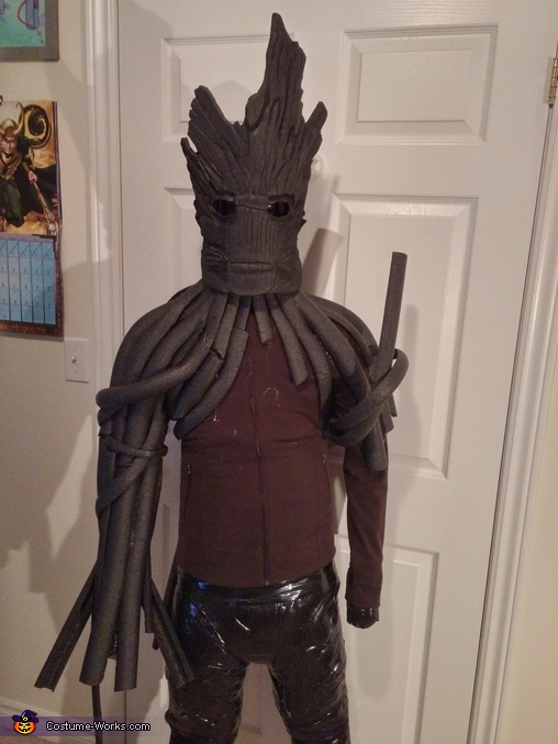 The slow process of layering Groot's vines onto a hoody. A lot of hot glue and foam pipe insulation., Guardians of the Galaxy Groot Costume