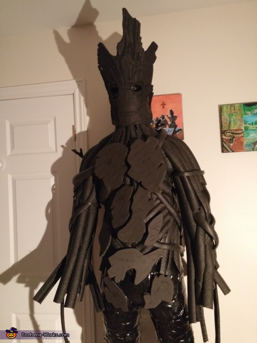 Cut body plates are temporarily placed before carving in details., Groot Costume