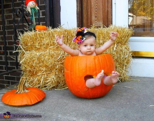 Baby Girl in a Pumpkin Costume