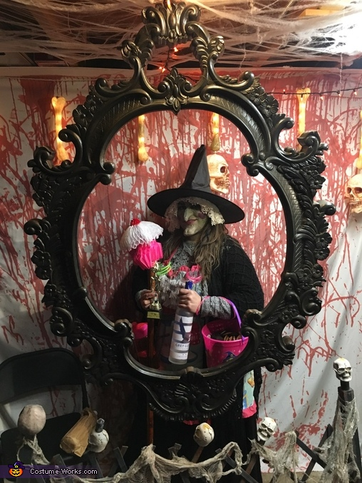 After winning best costume. A rotating skeleton trophy 'best costume' and a complimentary bottle of gray goose., Wicked Witch from Hansel and Gretel Disney characters Costume