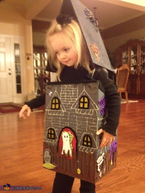 Sarah admires her Haunted House Costume, Haunted House Costume