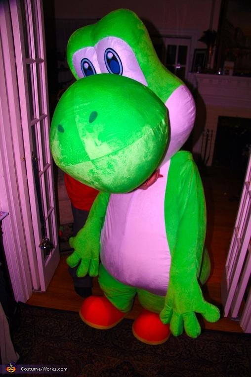 Holding Yoshi's head on son, Yoshi Costume