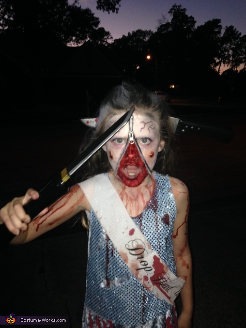 She'll cut you like she was cut!, Homecoming Horror Costume