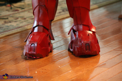 The foam covers are attached to an aqua-shoe. All he had to do was slip his foot into it., Iron Man Boy's Costume