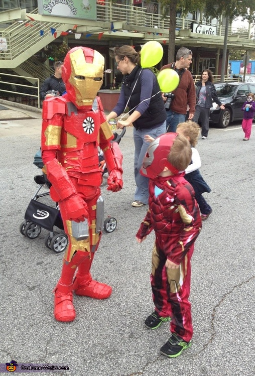 A junior Iron Man looks up in awe in the Halloween parade., Iron Man Costume