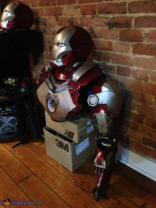 In the process of painting the suit and painting small battle damage detail, Iron Man Costume