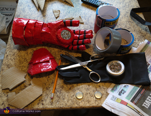 Building materials for the gloves; paper, rubber gloves, touch lights, duct tape, cardboard, Iron Man Mark VII Costume